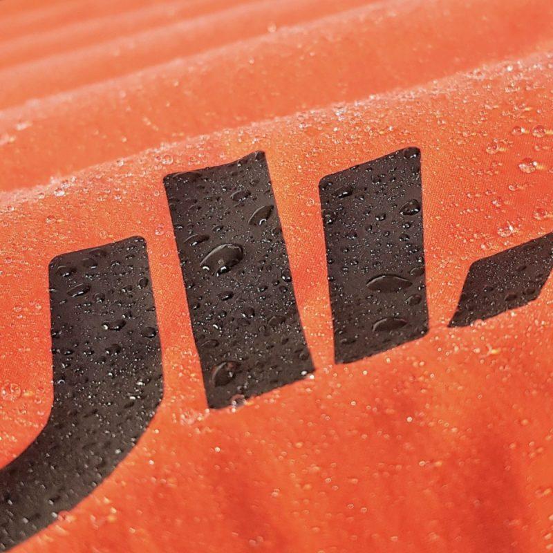 giacca-piuma-cordura-arancione-dettaglio-formentera-jaam-1